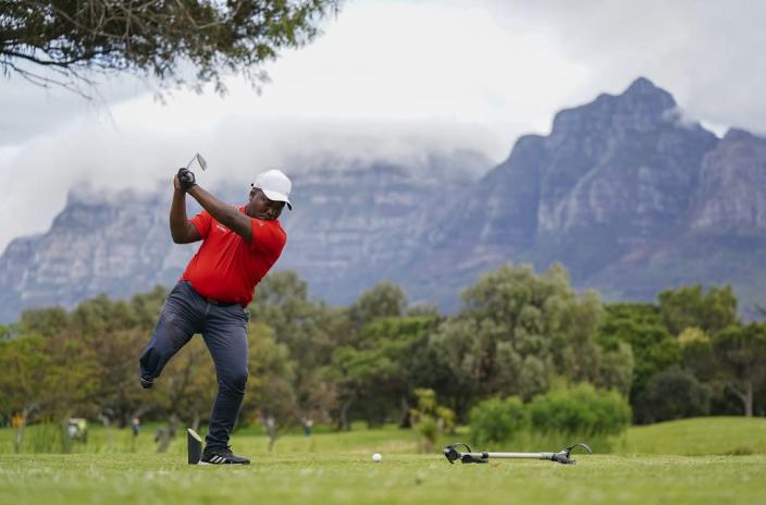 Single leg amputee Simo Mdudu of South Africa hits off the tee during the Cape Town Disabled Golf Open on the King David Mowbray Golf course in Cape Town, South Africa, 27 September 2021. Postponed for two years due to covid-19 the Cape Town Disabled Golf Open is one of the top disabled golf tournaments in the world. People suffering from any kind of physical disabilities including arm and leg amputees, hemiplegics, paraplegics, stroke victims, blind, and deaf people that are able to grip the club with at least one hand and hit the ball can compete.