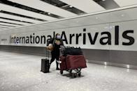 A passenger pushes a trolley through the Arrival Hall of Terminal 5 at London's Heathrow Airport after arriving into the UK following the suspension of the travel corridors. Passengers arriving from anywhere outside the UK, Ireland, the Channel Islands or the Isle of Man must have proof of a negative coronavirus test and self-isolate for 10 days. Picture date: Monday January 18, 2021. (Photo by Kirsty O'Connor/PA Images via Getty Images)