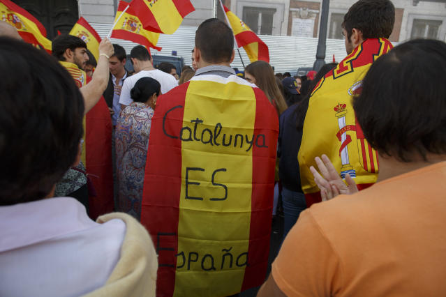 <p>A anti-separatist demonstrator wears a Spanish flags reading 'Catalonia is Spain' during a protest in support of Spain's unity as Catalonian votes in referendum on Oct. 1, 2017 in Madrid, Spain. (Photo: Pablo Blazquez Dominguez/Getty Images) </p>