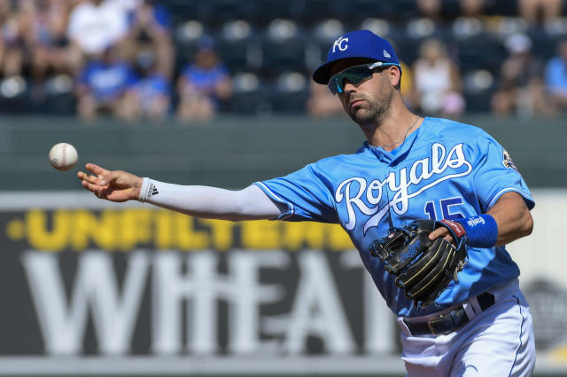 Kansas City Royals second baseman Whit Merrifield throws to first for an out against the Minnesota Twins during the third inning of a baseball game in Kansas City, Mo., Sunday, Sept. 16, 2018. (AP Photo/Reed Hoffmann)
