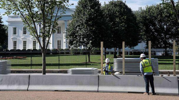PHOTO: Workers construct a protective barrier ahead of a higher fence being erected in front of the White House in Washington, D.C., July 15, 2019. (Nicholas Kamm/AFP/Getty Images)