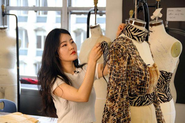 PHOTO: Seohee 'Ruby' Shin (FIT student) works on design for Nala ('The Lion King') inspired garments. (Disney)
