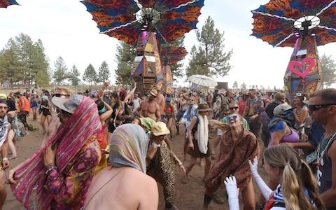 Festival goers dance at the Oregon Eclipse Festival - Credit: AFP