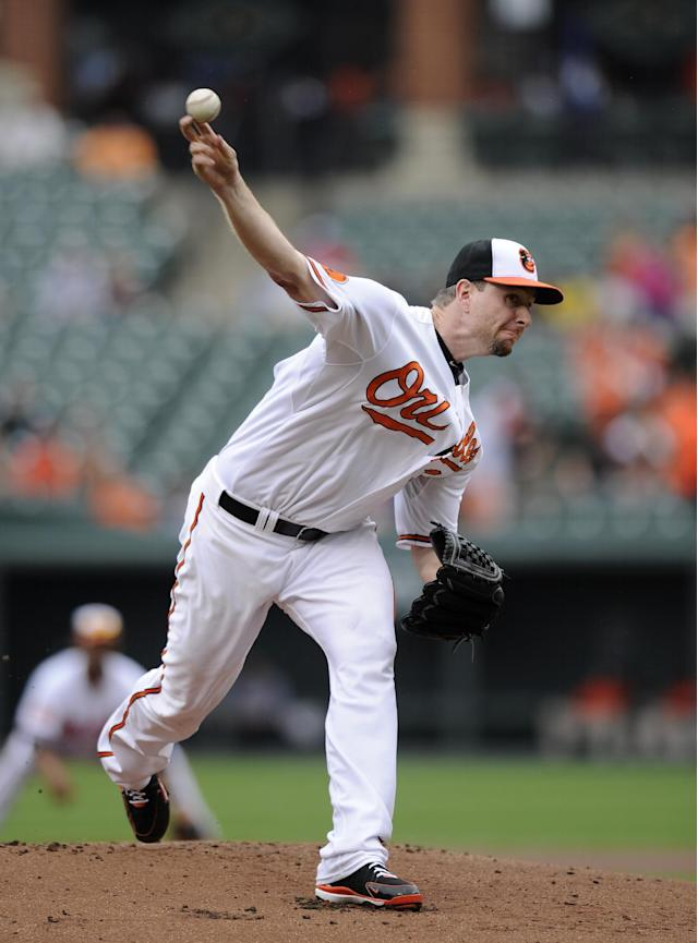 Baltimore Orioles starting pitcher Scott Feldman delivers against the Colorado Rockies during the first inning of a baseball game on Sunday, Aug. 18, 2013, in Baltimore. (AP Photo/Nick Wass)