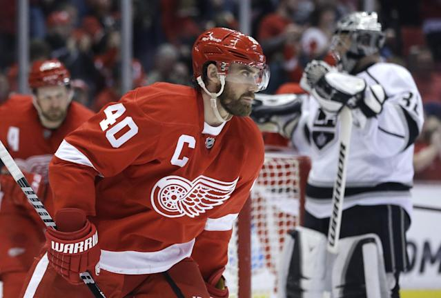 Detroit Red Wings left wing Henrik Zetterberg (40), of Sweden, skates in front of Los Angeles Kings goalie Jonathan Quick (32) after scoring a goal during the second period of an NHL hockey game in Detroit, Saturday, Jan. 18, 2014. (AP Photo/Carlos Osorio)