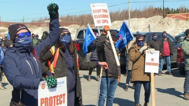 Dozens of fish harvesters and supporters protested on the doorstep of the office of Liberal MP Churence Rogers in Clarenville on Wednesday.  (Garrett Barry/CBC - image credit)
