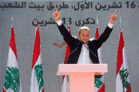 FILE PHOTO - Lebanese Foreign Minister and head of the Free Patriotic Movement (FPM) Gebran Bassil gestures to his supporters, during a rally to show support for him and calling to elect a president, near the presidential palace in Baabda
