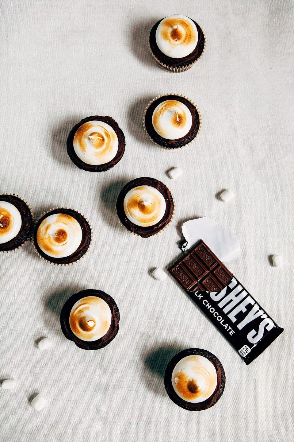 """<p>What's more American than a good, old-fashioned campfire? Oh yeah, s'mores.<em><br></em></p><p><a href=""""http://www.hummingbirdhigh.com/2015/02/triple-chocolate-double-graham-smores.html"""" rel=""""nofollow noopener"""" target=""""_blank"""" data-ylk=""""slk:Get the recipe from Hummingbird High »"""" class=""""link rapid-noclick-resp""""><em>Get the recipe from Hummingbird High »</em></a></p>"""