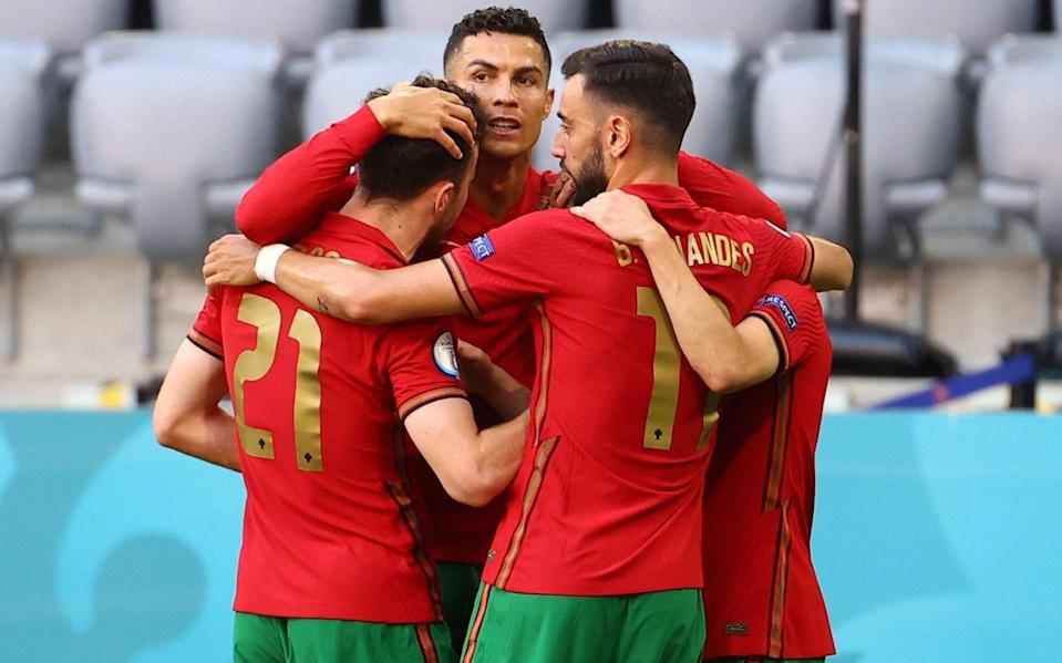 Cristiano Ronaldo celebrates with his teammates after scoring for Portugal against the run of play - REUTERS