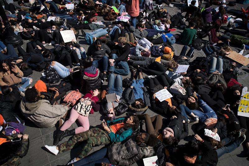 Student activists participate in a 'die-in' to protest gun violence near the campus of New York University on April 20, 2018, the anniversary of the 1999 mass shooting at Columbine High School in Colorado.