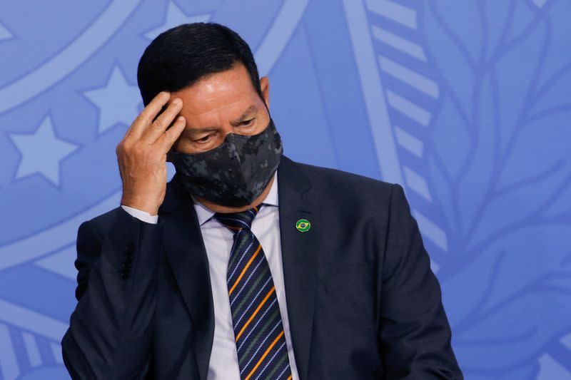 Brazil's Vice President Hamilton Mourao gestures during an inauguration ceremony of the new Health Minister in Brasilia