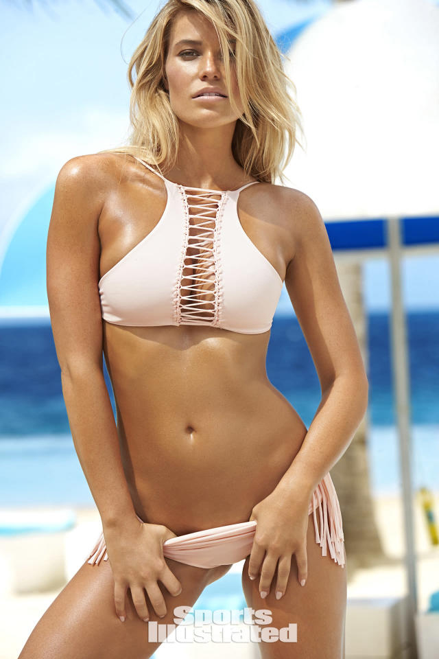 "<p>Samantha Hoopes was photographed by Ben Watts in Curacao. Swimsuit by <a href=""http://www.anrdoezrs.net/links/8148014/type/dlg/sid/SISWIMsamhoopes/http://www.revolve.com/indah-lynx-high-neck-macrame-bikini-top/dp/INDA-WX233/?d=Womens"" rel=""nofollow noopener"" target=""_blank"" data-ylk=""slk:INDAH"" class=""link rapid-noclick-resp"">INDAH</a>, available at <a href=""http://www.anrdoezrs.net/links/8148014/type/dlg/sid/SISWIMsamhoopes/http://www.revolve.com/indah-lynx-high-neck-macrame-bikini-top/dp/INDA-WX233/?d=Womens"" rel=""nofollow noopener"" target=""_blank"" data-ylk=""slk:revolve.com"" class=""link rapid-noclick-resp"">revolve.com</a>.</p>"