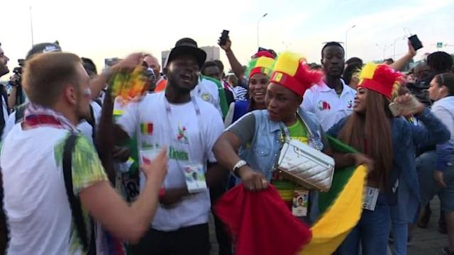 Poland and Senegal fans react as Senegal becomes the first African nation to win a match at the 2018 World Cup, beating Poland 2-1 in Moscow.