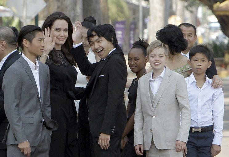 Angelina Jolie, second from left, waves with her adopted children Pax, left, Maddox, center, Zahara, third from right, and Shiloh