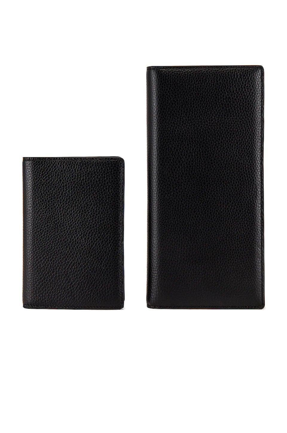 <p>You can store all your essentials in this sleek <span>The Daily Edited Black Pebbled Travel Wallet</span> ($53, originally $150).</p>