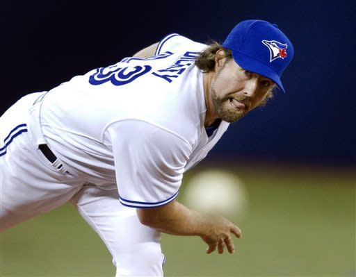 In this photo provided by the Toronto Blue Jays, Toronto Blue Jays starting pitcher R.A Dickey throws against the Cleveland Indians in the first inning of their opening day baseball game in Toronto on Tuesday, April 2, 2013. (AP Photo/Toronto Blue Jays via The Canadian Press, Fred Thornhill)