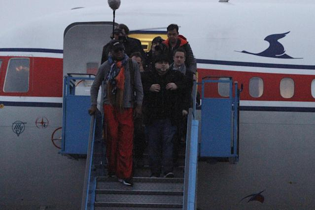 Former NBA basketball star Dennis Rodman disembarks from a North Korean Air Koryo flight from Beijing as he and his entourage arrive at the international airport in Pyongyang, North Korea on Thursday, Dec. 19, 2013. (AP Photo/Kim Kwang Hyon)
