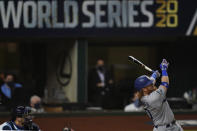 Los Angeles Dodgers' Justin Turner watches his home run against the Tampa Bay Rays during the first inning in Game 3 of the baseball World Series Friday, Oct. 23, 2020, in Arlington, Texas. (AP Photo/Eric Gay)
