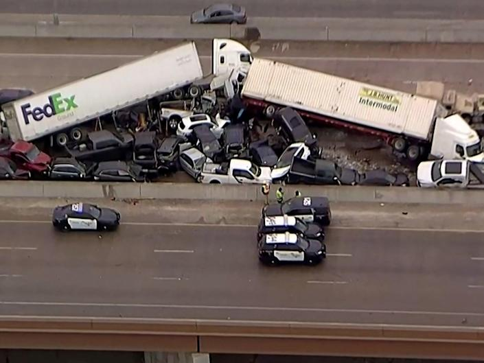 <p>Cars and trucks are wedged together after a deadly multi-vehicle pileup on the ice covered I-35 in a still image from video in Fort Worth, Texas, on 11 February 2021</p> ((Reuters))
