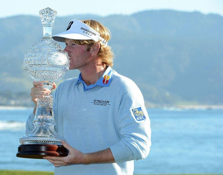 Brandt Snedeker poses with the trophy on February 10, 2013 in Pebble Beach, California