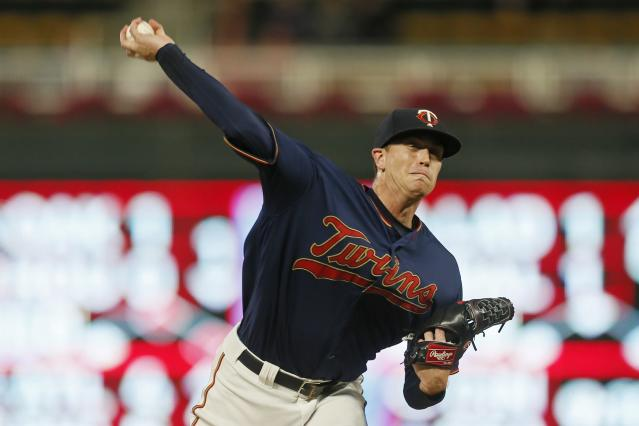 Minnesota Twins pitcher Kyle Gibson throws against the Washington Nationals in the first inning of a baseball game Thursday, Sept. 12, 2019, in Minneapolis. (AP Photo/Jim Mone)