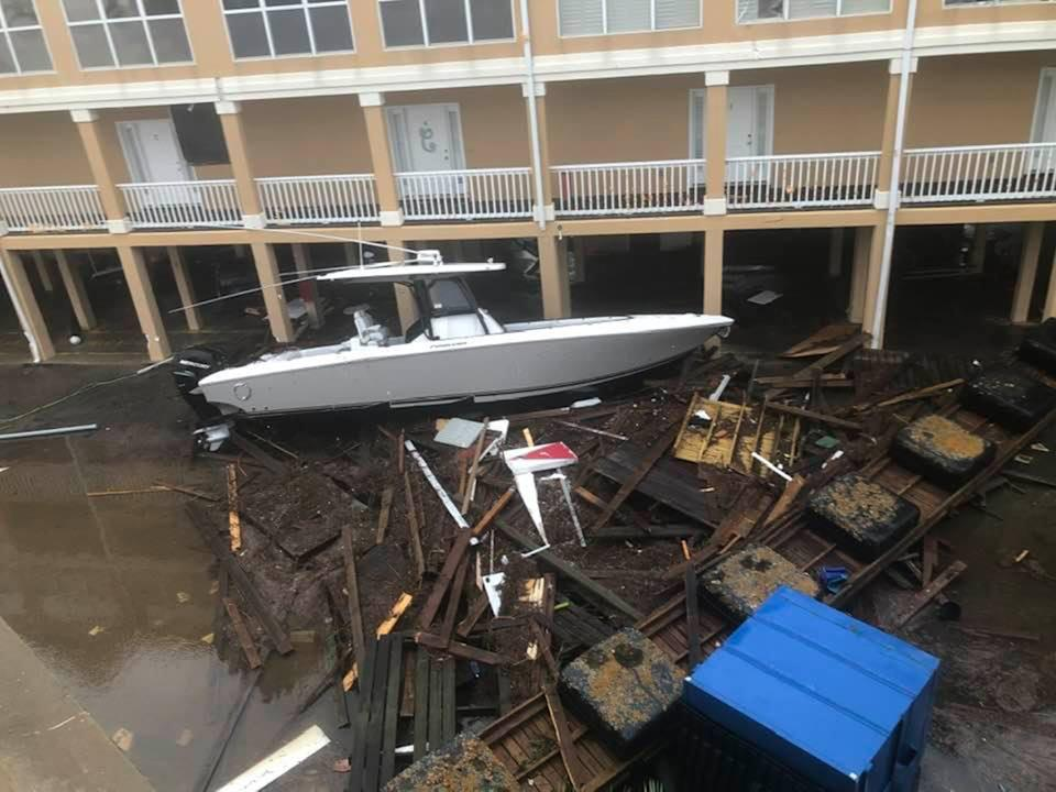 A boat and debris were washed into a building in Orange Beach on Wednesday.