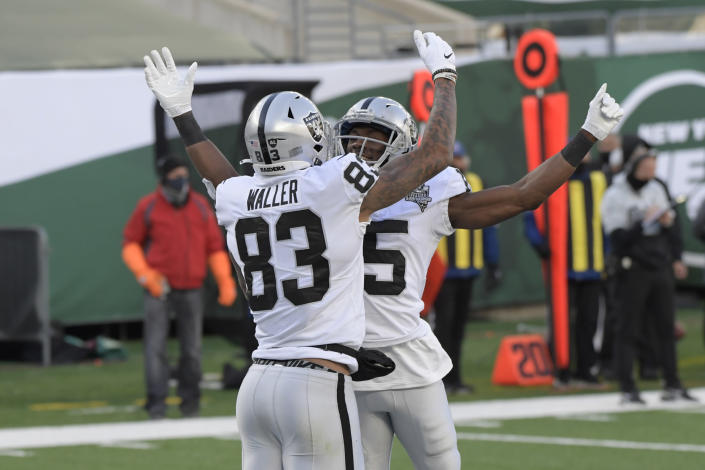 Las Vegas Raiders' Darren Waller (83), left, celebrates his touchdown with Nelson Agholor during the first half an NFL football game against the New York Jets, Sunday, Dec. 6, 2020, in East Rutherford, N.J. (AP Photo/Bill Kostroun)