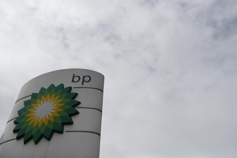 FILE - This Aug. 4, 2020 file photo shows the logo of British Petroleum in west London. Oil giants Exxon and BP have reported staggering losses for 2020 as the pandemic crushed energy demand and caused oil prices to tumble. (AP Photo/Alastair Grant, File)