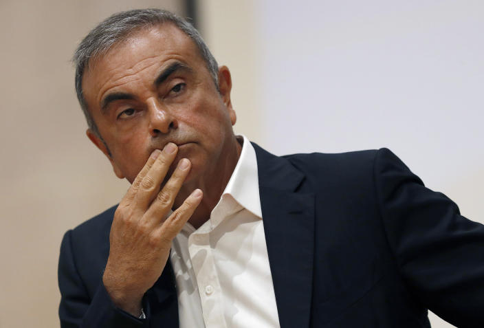 FILE - In this Sept. 29, 2020, file photo, former Nissan Motor Co. Chairman Carlos Ghosn holds a press conference at the Maronite Christian Holy Spirit University of Kaslik, as he launches an initiative to help Lebanon that is undergoing a severe economic and financial crisis, in Kaslik, north of Beirut, Lebanon. A U.S. judge on Thursday, Jan. 28, 2021 cleared the way for the extradition of an American father and son wanted by Japan for smuggling former Nissan Motor Co. Chairman Carlos Ghosn out of the country while he was awaiting trial. U.S. District Judge Indira Talwani rejected a request to block the U.S. from handing Michael Taylor and his son, Peter Taylor, over to Japan. (AP Photo/Hussein Malla, File)