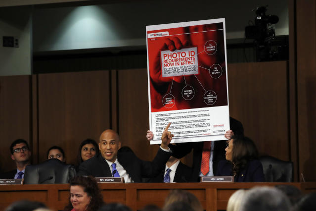 Sen. Cory Booker, D-N.J., points at an example of voter ID signage as he questions Brett Kavanaugh on Sept. 5. (Photo: Jacquelyn Martin/AP)