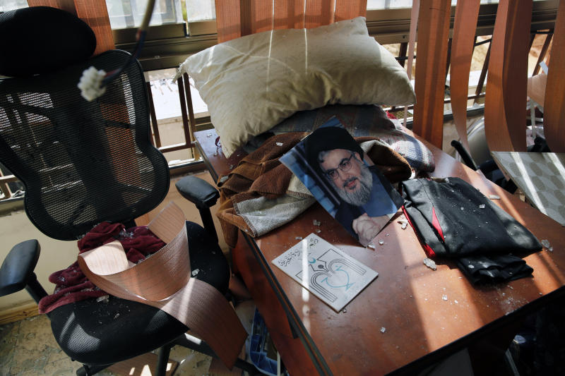 FILE - In this Sunday, Aug. 25, 2019 file photo, a picture of Hezbollah leader Sayyed Hassan Nasrallah lies amid other damage inside the Lebanese Hezbollah media office, in a southern suburb of Beirut, Lebanon. The long shadow war between Israel and Iran has burst into the open in recent days, with Israel allegedly striking Iran-linked targets as far away as Iraq and crash-landing two drones in Lebanon. These incidents, along with an air raid in Syria that Israel says thwarted an imminent Iranian drone attack, have raised tensions at a particularly fraught time. (AP Photo/Bilal Hussein, File)