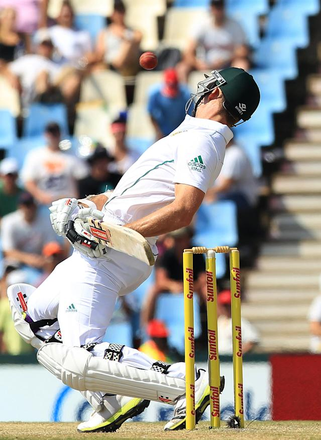 South Africa's batsman Ryan McLaren, avoids a bouncer off Australia's bowler Mitchell Johnson, not pictured, on the fourth day of their their cricket test match at Centurion Park in Pretoria, South Africa, Saturday, Feb. 15, 2014. (AP Photo/ Themba Hadebe)