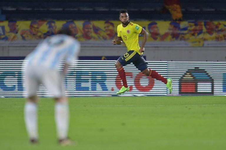 Colombia's Miguel Borja wheels away to celebrate his dramatic equalizer as Argentina captain Lionel Messi looks on