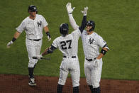 New York Yankees' Aaron Judge, right, celebrates his two-run home run with Giancarlo Stanton (27), center, and DJ LeMahieu during the third inning of the baseball game against the Boston Red Sox at Yankee Stadium, Friday, July 31, 2020, in New York. (AP Photo/Seth Wenig)