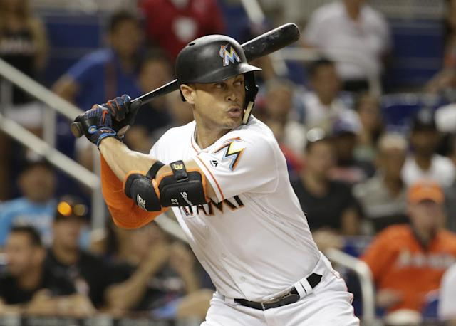Giancarlo Stanton's name has popped up in trade rumors. (AP Images)
