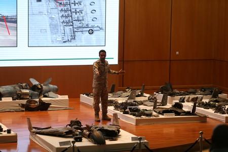 Saudi defence ministry spokesman Colonel Turki Al-Malik displays remains of the missiles which Saudi government says were used to attack an Aramco oil facility, during a news conference in Riyadh