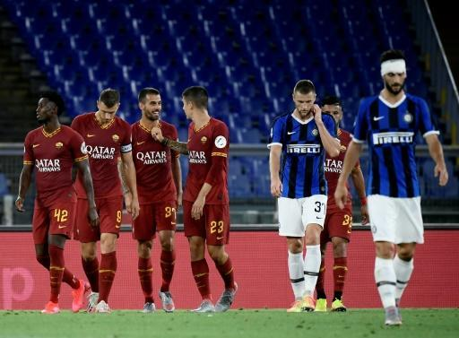 Roma's Leonardo Spinazzola (3rd L) celebrates after scoring aginst Inter Milan at the Olympic Stadium in Rome
