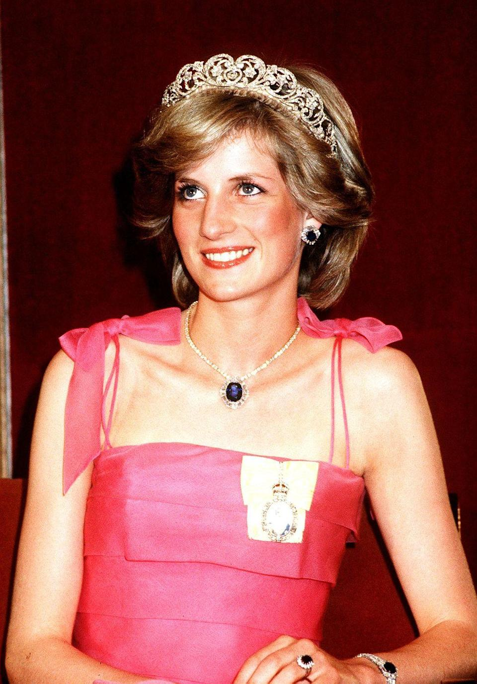 <p>Diana busted out her major jewels for this event. This sapphire and diamond necklace match her engagement ring, and were casually given to her by the Saudi royal family on her wedding day.</p>