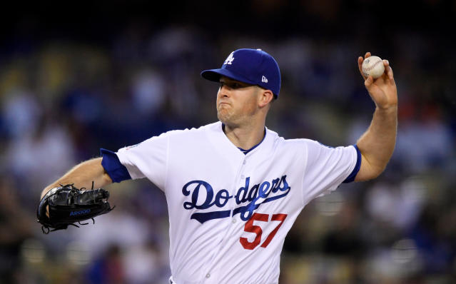 Los Angeles Dodgers starting pitcher Alex Wood throws to the plate during the first inning of a baseball game against the San Francisco Giants, Friday, March 30, 2018, in Los Angeles. (AP Photo/Mark J. Terrill)
