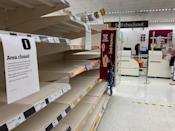 A view shows empty shelves in a supermarket during the first evening of the welsh lockdown, amid the coronavirus disease (COVID-19) outbreak, in Tenby, Wales, Britain October 23, 2020. REUTERS/Rebecca Naden