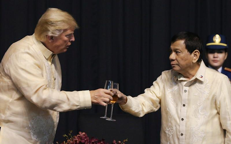 Donald Trump with Philippines President Rodrigo Duterte in Manila in November - Reuters pool