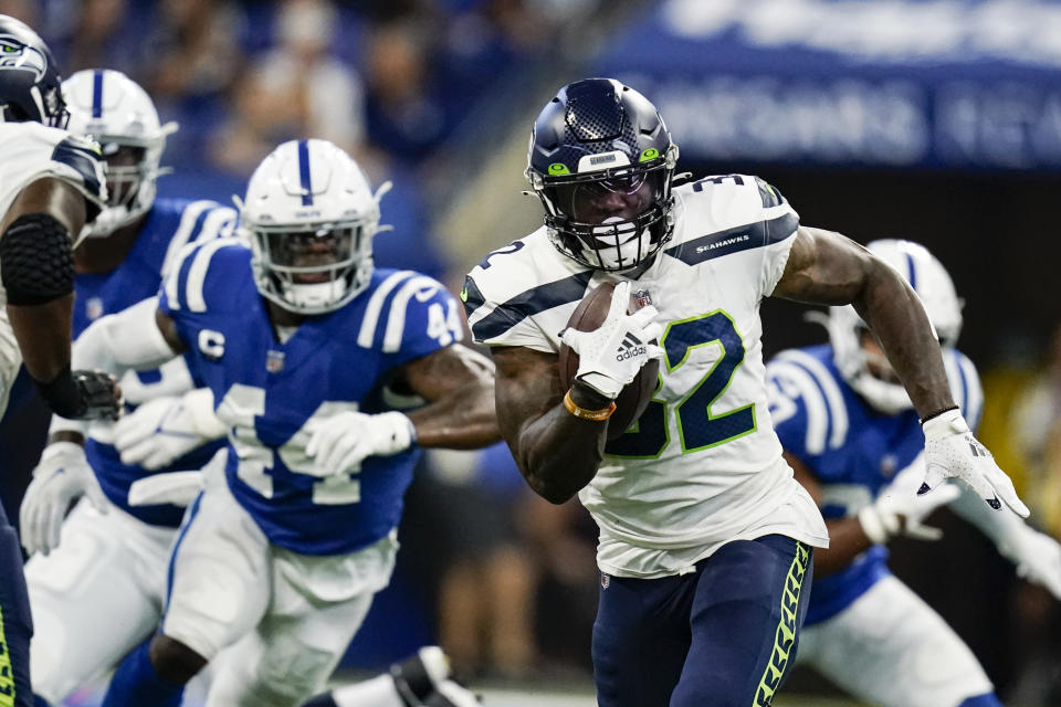 Seattle Seahawks running back Chris Carson (32) runs against the Indianapolis Colts in the first half of an NFL football game in Indianapolis, Sunday, Sept. 12, 2021. (AP Photo/Charlie Neibergall)