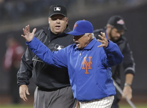 New York Mets manager Terry Collins gestures as he leaves the field, yelling at third base umpire Fieldin Culbreth after second base umpire Adrina Johnson threw Collins out of the game for arguing a call at second base in the sixth inning of an interleague baseball game against the New York Yankees at Citi Field in New York, Tuesday, May 28, 2013. (AP Photo/Kathy Willens)