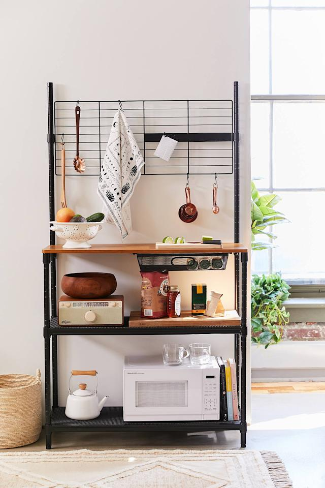 """<p>If you're lacking kitchen space, invest in this <a href=""""https://www.popsugar.com/buy/Kitchen-Storage-Station-498197?p_name=Kitchen%20Storage%20Station&retailer=urbanoutfitters.com&pid=498197&price=229&evar1=casa%3Auk&evar9=46719307&evar98=https%3A%2F%2Fwww.popsugar.com%2Fhome%2Fphoto-gallery%2F46719307%2Fimage%2F46719396%2FKitchen-Storage-Station&list1=shopping%2Corganization%2Capartments%2Chome%20organization&prop13=api&pdata=1"""" rel=""""nofollow"""" data-shoppable-link=""""1"""" target=""""_blank"""" class=""""ga-track"""" data-ga-category=""""Related"""" data-ga-label=""""https://www.urbanoutfitters.com/shop/kitchen-station-storage?category=SEARCHRESULTS&amp;color=001"""" data-ga-action=""""In-Line Links"""">Kitchen Storage Station</a> ($229).</p>"""