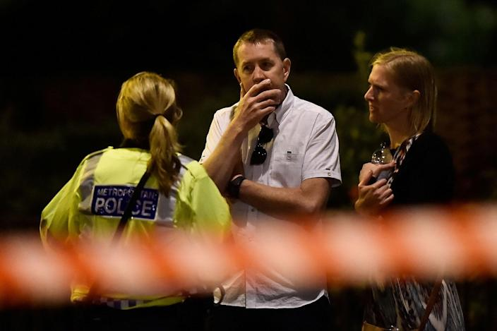 <p>People react as police attend to an incident near London Bridge in London, Britain, June 4, 2017. (Hannah McKay/Reuters) </p>