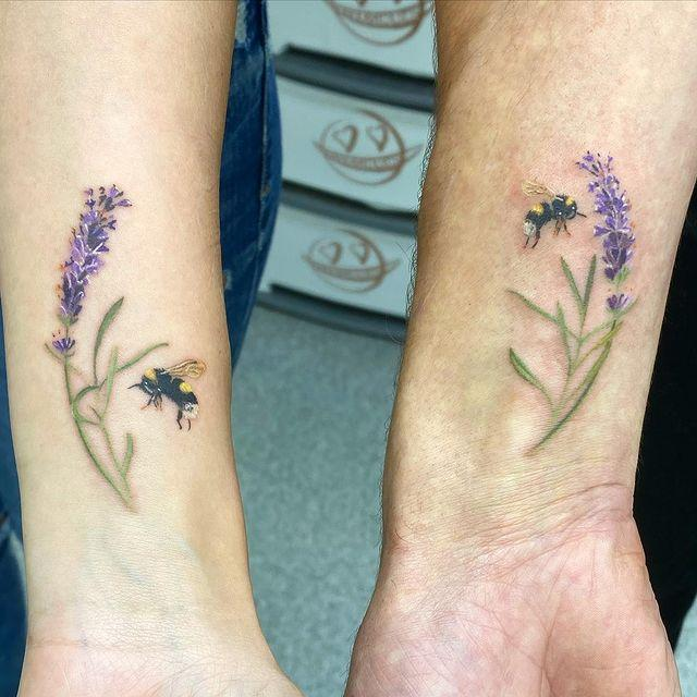 """<p>I'm a sucker for lavender sprig tattoos—there's just something about purple ink that looks so pretty!—but I love how this design is made extra special with a couple of bees floating around.</p><p><a href=""""https://www.instagram.com/p/CHD2RvkM8g6/"""" rel=""""nofollow noopener"""" target=""""_blank"""" data-ylk=""""slk:See the original post on Instagram"""" class=""""link rapid-noclick-resp"""">See the original post on Instagram</a></p>"""
