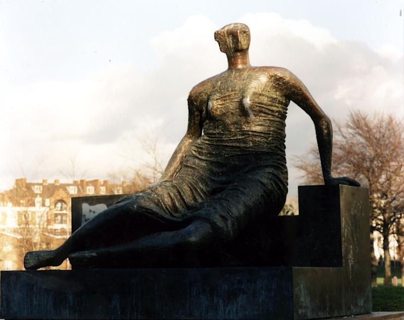 """FILE - In this June. 3, 1996 file photo of Henry Moore's sculpture """"Draped, Seated Woman"""". A cash-strapped authority in east London says it's selling a valuable Henry Moore statue over the objections of leading British arts figures including director Danny Boyle. London's Tower Hamlets Council said late Wednesday, Nov. 7, 2012, that """"Draped Seated Woman,"""" which stood for years on a public housing complex in the city's East End, would be sold """"due to the massive government cuts we are facing."""" (AP Photo/PA, File) UNITED KINGDOM OUT  NO SALES  NO ARCHIVE"""