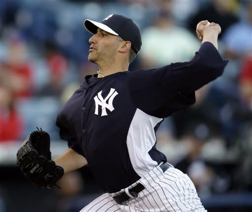New York Yankees starting pitcher Andy Pettitte (46) delivers in the first inning of an exhibition spring training baseball game against the Philadelphia Phillies in Tampa, Fla., Wednesday, March 13, 2013. (AP Photo/Kathy Willens)