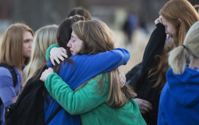 Students embrace after a prayer vigil in Paducah, Ky., on Wednesday, in honor of the victims of the Marshall County High School shooting the day before. (Ryan Hermens/The Paducah Sun via AP)