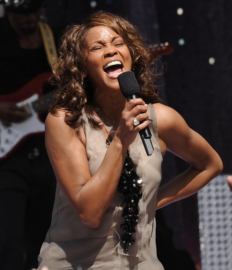 "FILE - In this Sept. 1, 2009  file photo, singer Whitney Houston performs on ""Good Morning America"" in New York's Central Park. Houston, who reigned as pop music's queen until her majestic voice and regal image were ravaged by drug use, has died, Saturday, Feb. 11, 2012. She was 48. (AP Photo/Evan Agostini, File)"